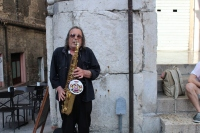 A saxaphone player making some sweet tunes in Urbino, Italy.