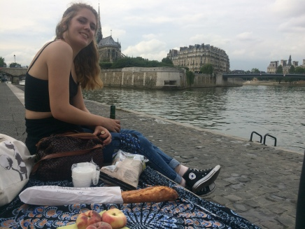 My friend Natalya and I enjoying a nice picnic on the Seine