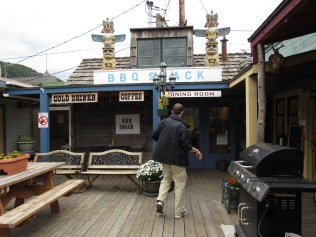 My brother sauntering into The BBQ Shack in Skagway where they serve elk and caribou burgers.